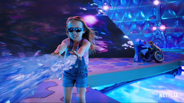 A Sharkboy and Lavagirl child shooting water from her hands
