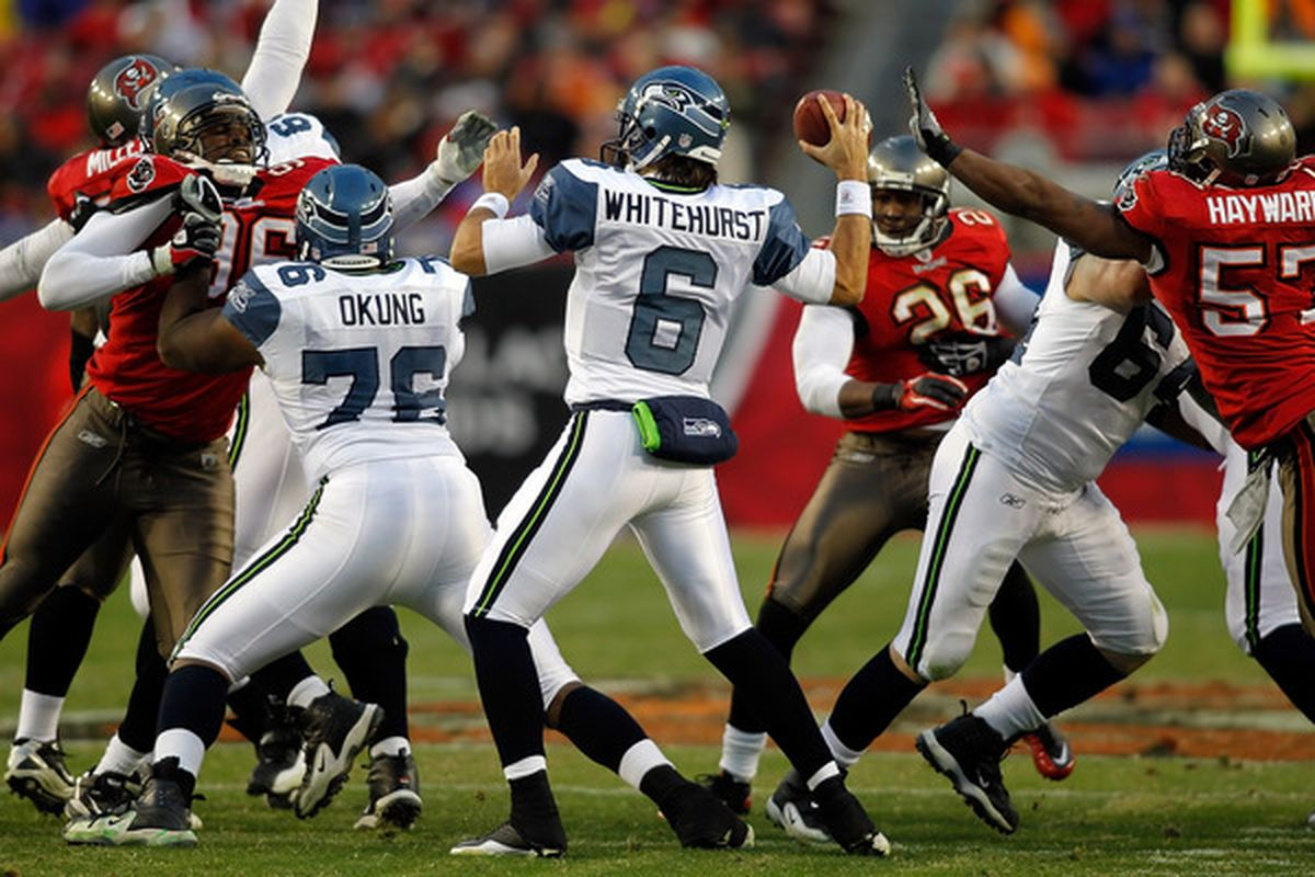 TAMPA FL - DECEMBER 26:  Quarterback Charlie Whitehurst #6 of the Seattle Seahawks throws a pass against the Tampa Bay Buccaneers during the game at Raymond James Stadium on December 26 2010 in Tampa Florida.  (Photo by J. Meric/Getty Images)