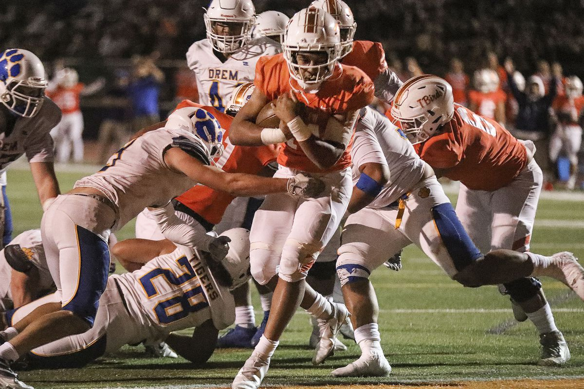Timpview's Micah Beckstead (14) scores in the game against Orem at Timpview High in Orem on Thursday, Sept. 30, 2021.