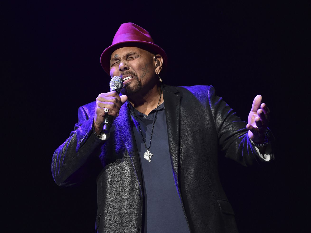 """Singer Aaron Neville performs during """"A Concert For Island Relief"""" at Radio City Music Hall in New York, in 2018."""