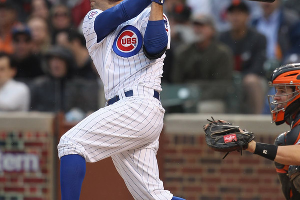 Reed Johnson of the Chicago Cubs hits a run-scoring triple in the 7th inning against the San Francisco Giants at Wrigley Field in Chicago, Illinois. The Cubs defeated the Giants 11-4. (Photo by Jonathan Daniel/Getty Images)