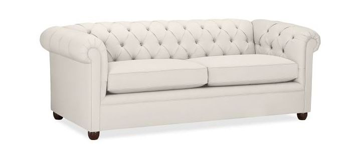 Tufted sofa in off-white color.
