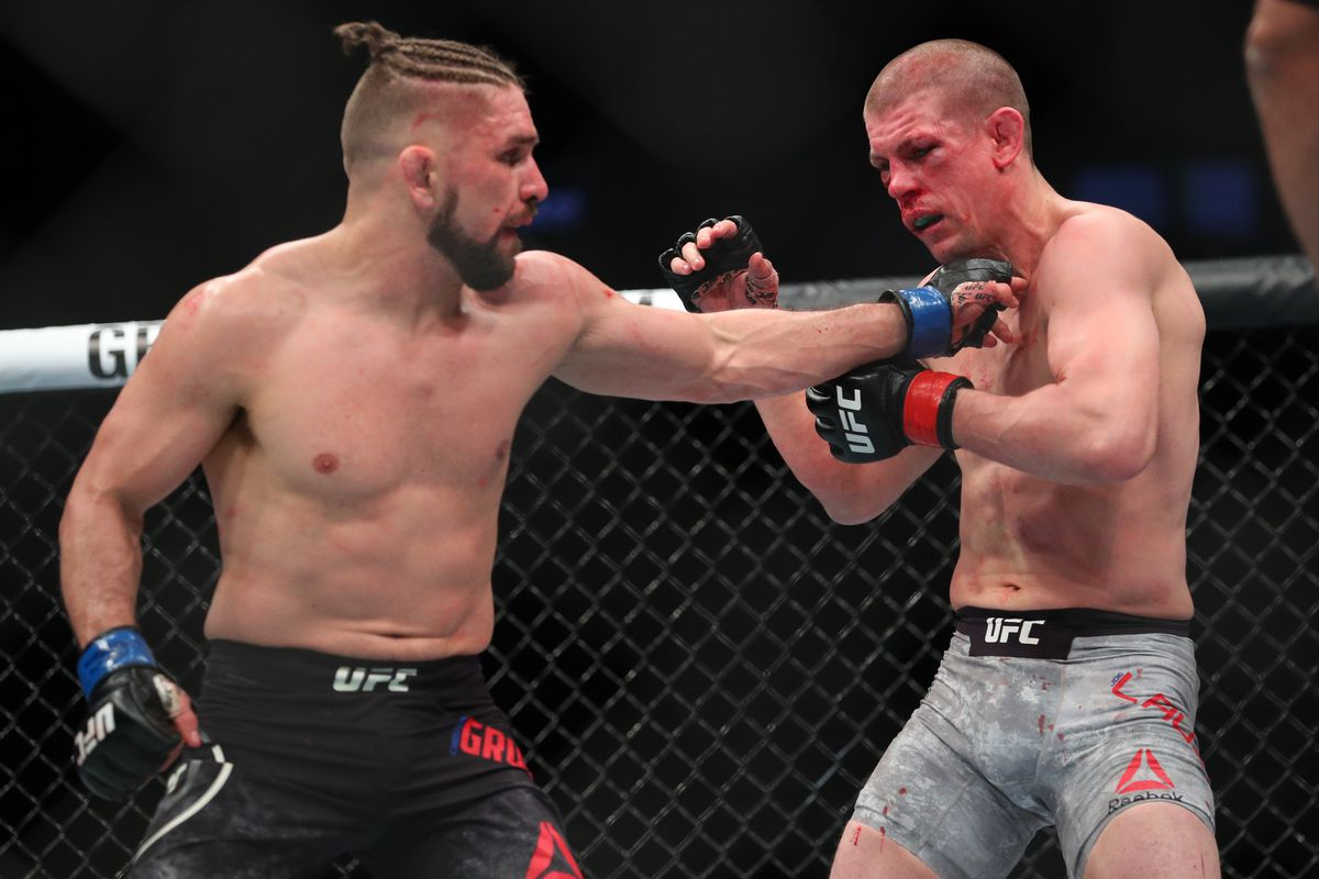 Chris Gruetzemacher lands a left hand to the head of Joe Lauzon during their lightweight bout at UFC 223 at Barclays Center on April 7, 2018 in New York City.