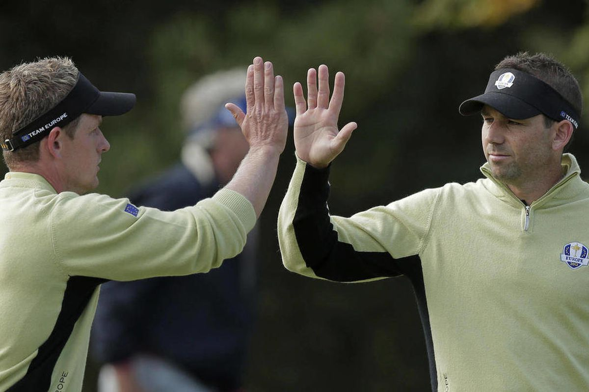 Europe's Luke Donald, left, and Sergio Garcia react after Donald made a putt on the 10th hole during a foursomes match at the Ryder Cup PGA golf tournament Friday, Sept. 28, 2012, at the Medinah Country Club in Medinah, Ill.