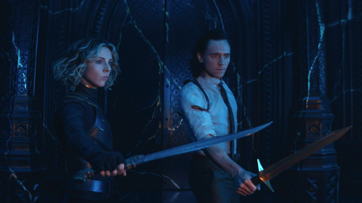 Loki and Sylvie hold their swords out as they face the season finale villain in Loki