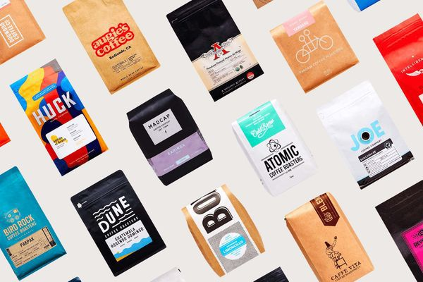Assorted packages of coffee beans on a white background