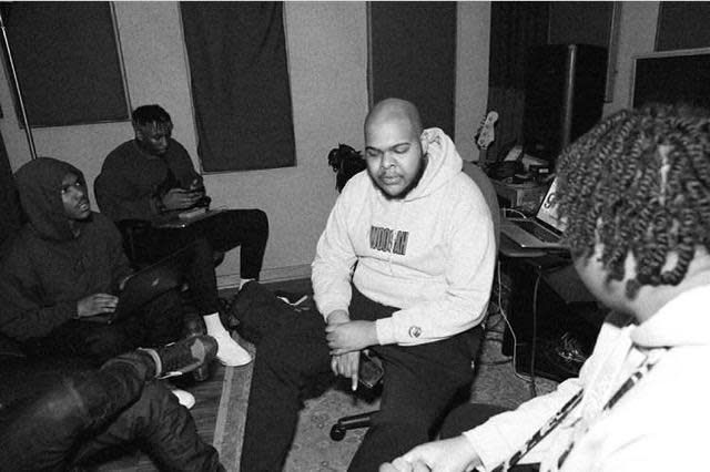 (left to right counterclockwise) Smino (in hoodie), , Groove, Johnny Venus (behind Groove), Monte Booker