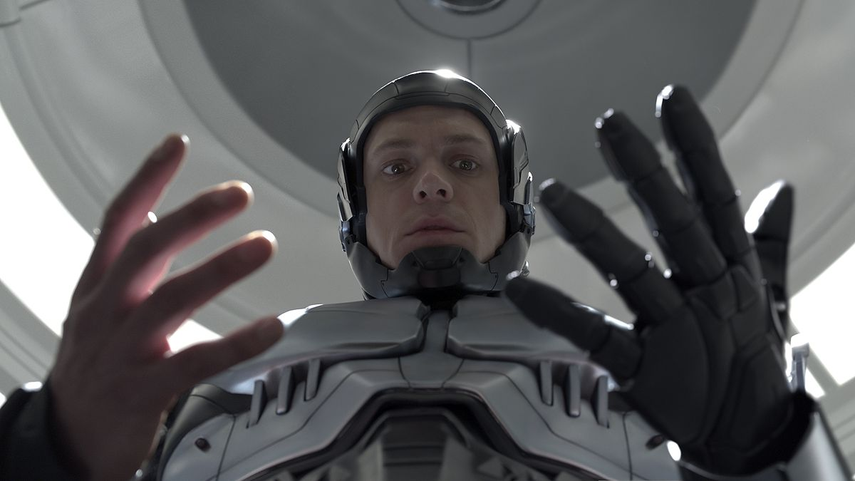 a man looks down at his hands