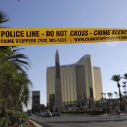 Part of Reno Ave. near South Las Vegas Blvd is blocked with police tape in the aftermath of a mass shooting Wednesday, Oct. 4, 2017, in Las Vegas. A gunman opened fire on an outdoor music concert on Sunday. It was the deadliest mass shooting in modern U.S. history, with dozens killed and hundreds injured, some by gunfire, some during the chaotic escape. (AP Photo/Marcio Jose Sanchez)