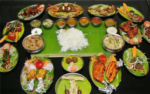 A spread of south Indian dishes on banana leaves at Royal Chef