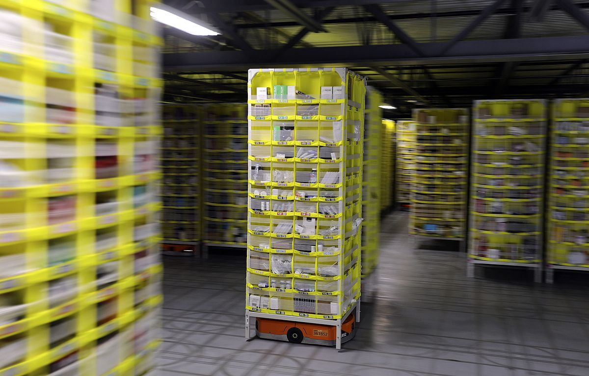 Products are transported on Amazon Robotics robots through the new Amazon Fulfillment Center in Salt Lake City on Wednesday, April 17, 2019.