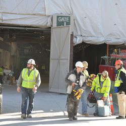Workers leaving the ballpark having bags inspected -