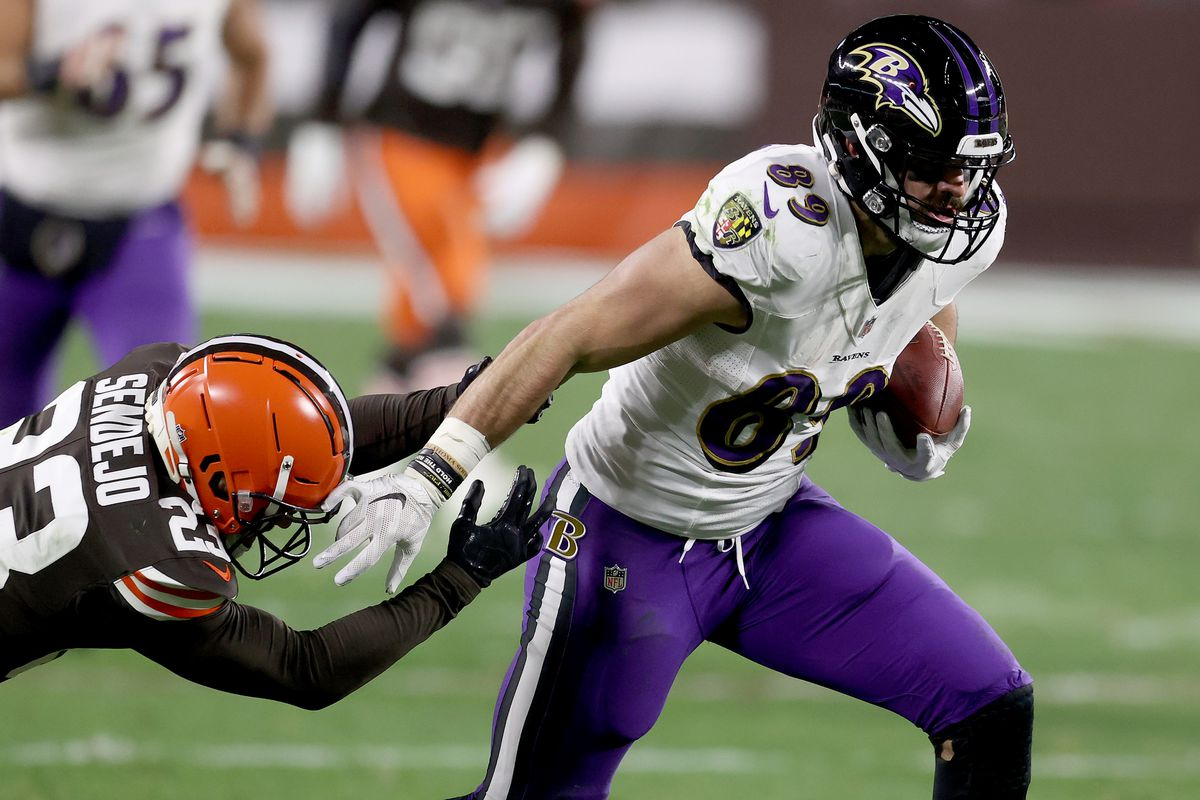Mark Andrews #89 of the Baltimore Ravens brushes away a tackle attempt by Andrew Sendejo #23 of the Cleveland Browns during the second quarter in the game at FirstEnergy Stadium on December 14, 2020 in Cleveland, Ohio.