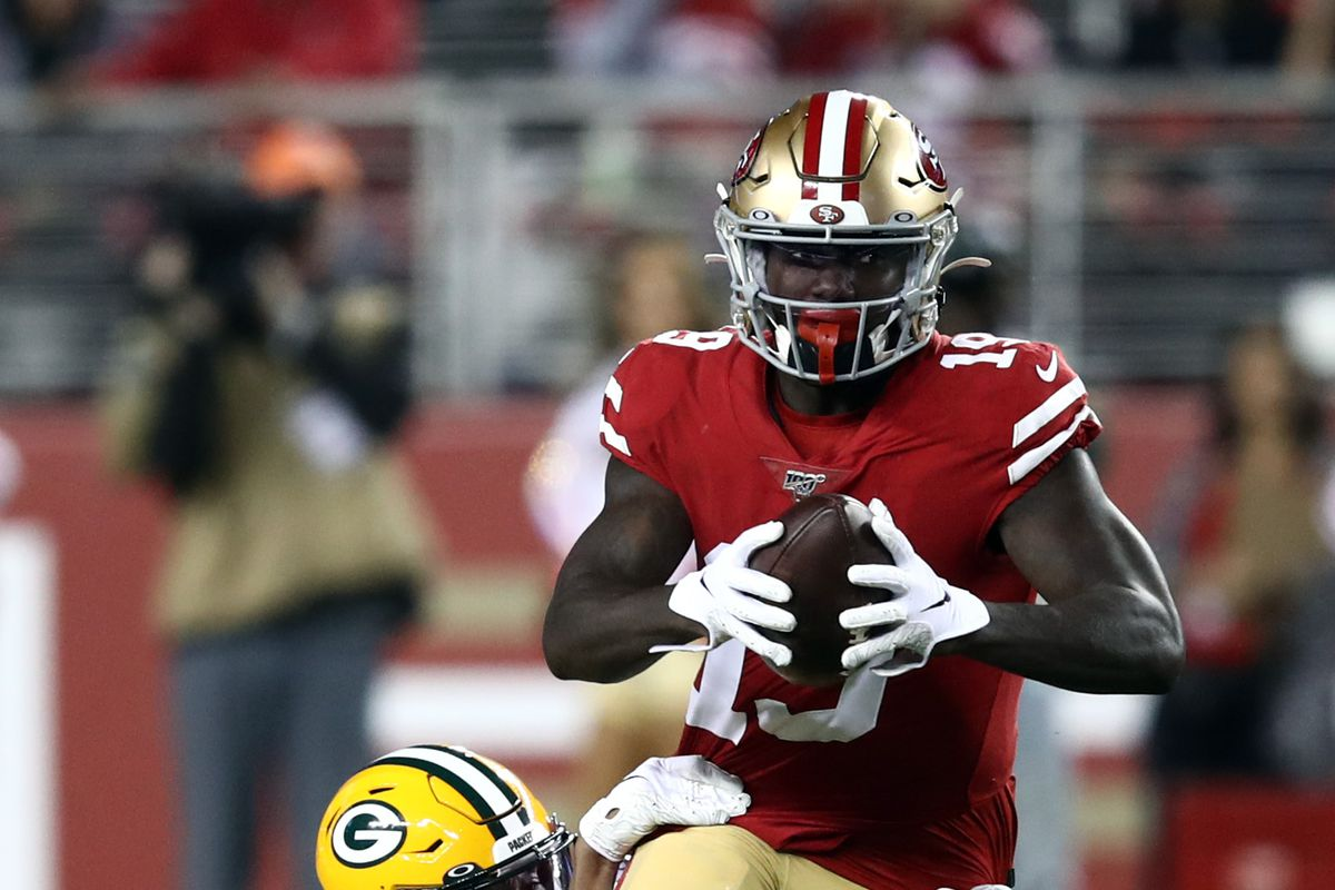 Wide receiver Deebo Samuel of the San Francisco 49ers carries the ball after making a catch as cornerback Kevin King of the Green Bay Packers defends during the 1st quarter of the game at Levi's Stadium on November 24, 2019 in Santa Clara, California.