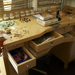 Drawers filled with jewelry wax, tools, metals and more.