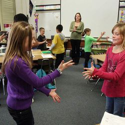 Emma Webster, left, and Brooklyn Wersland exercise in Nicole Carter's class at Tolman Elementary School in Bountiful, Monday, Nov. 26, 2012.