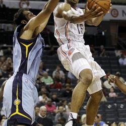 Charlotte Bobcats' Gerald Henderson, right, drives past Memphis Grizzlies' Hamed Haddadi, of Iran, during the first half of an NBA basketball game in Charlotte, N.C., Friday, April 20, 2012.