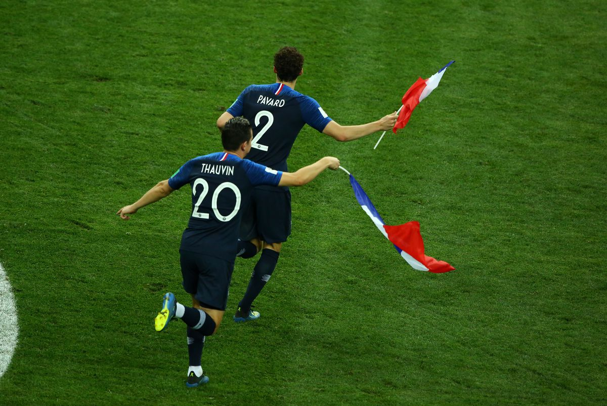 France v Croatia - 2018 FIFA World Cup Russia Final France v Croatia - FIFA World Cup Russia 2018 Final Benjamin Pavard (France) and Florian Thauvin (France) celebrate with france flags on the pitch at Luzhniki Stadium in Moscow, Russia on July 15, 2018.