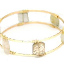 """<a href=""""http://www.etsy.com/listing/177409926/ladder-bangle?ref=shop_home_active_6"""">Bangle,</a> by Mallory Shelter at Etsy, $84 for sterling silver, $88 for 14K gold fill"""