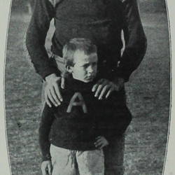 An unidentified player with an unidentified child.