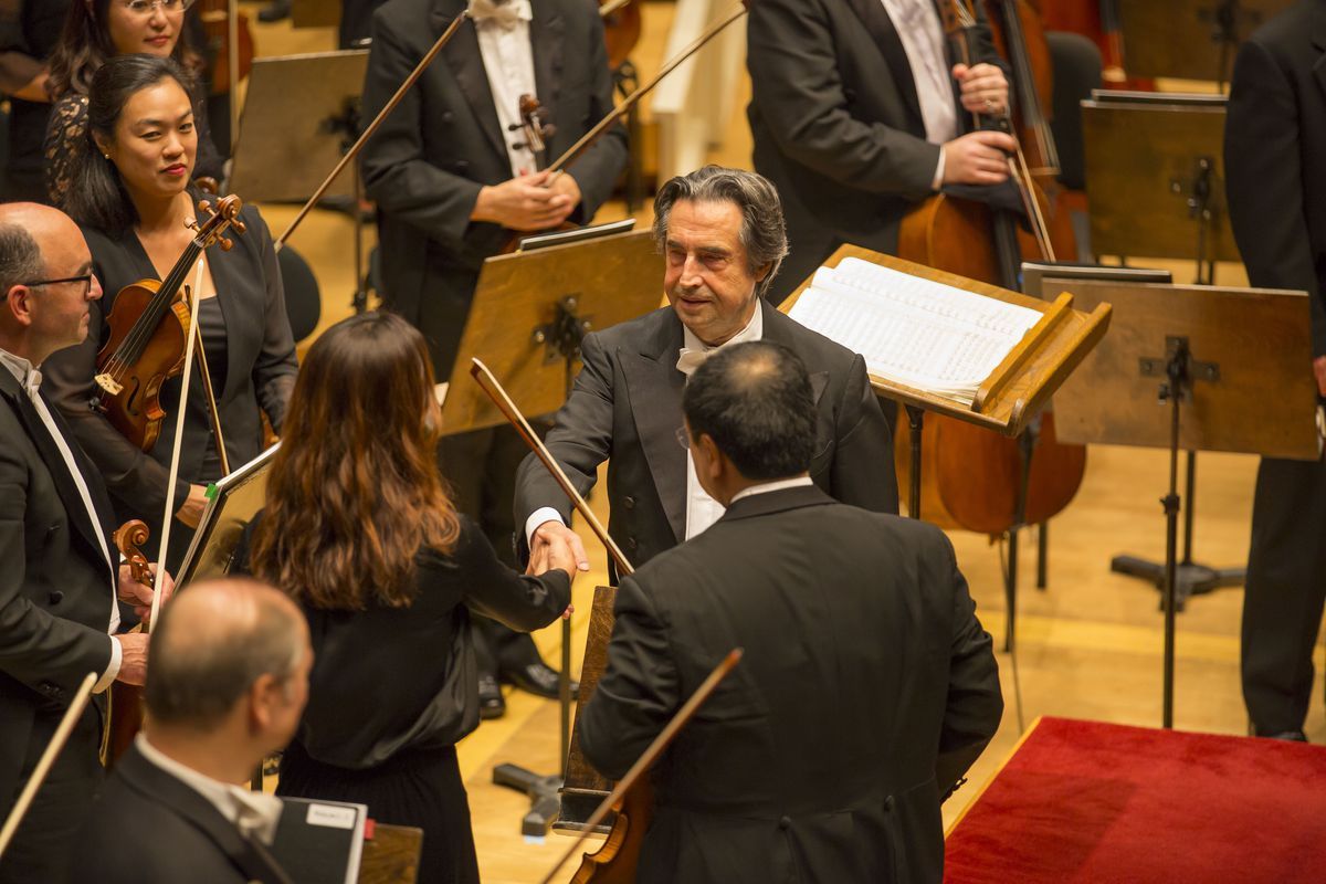 """The Chicago Symphony Orchestra, Maestro Riccardo Muti conductor, congratulates his musicians following a performance of Bruckner's """"Symphony No. 7."""" (Photo: Todd Rosenberg Photography)"""