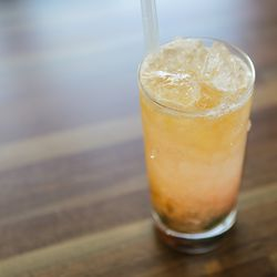 The Smoked Swizzle is modeled after the textures of melted shave ice.