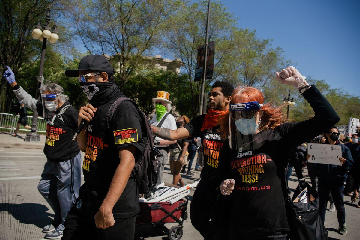 Members of Revolution Club Chicago lead a march Saturday along Michigan Avenue.