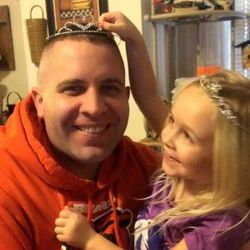 Jerry Ellis and his oldest daughter, Kaylee, as she puts a tiara on the Illinois State Trooper's head. | Provided