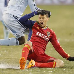 Real's Javier Morales gets hit in the head as he slides to the ground as Real Salt Lake and Sporting KC play Saturday, Dec. 7, 2013 in MLS Cup action. Sporting KC won in a shootout.