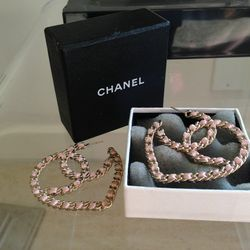 """Chanel earrings, <a href=""""http://www.ebay.com/itm/Lilly-Ghalichi-Gorgeous-Chanel-SOLD-OUT-Pink-with-Gold-CC-earrnigs-MUST-SEE-/181055654909?pt=Fashion_Jewelry&hash=item2a27c20bfd"""">$760</a>."""