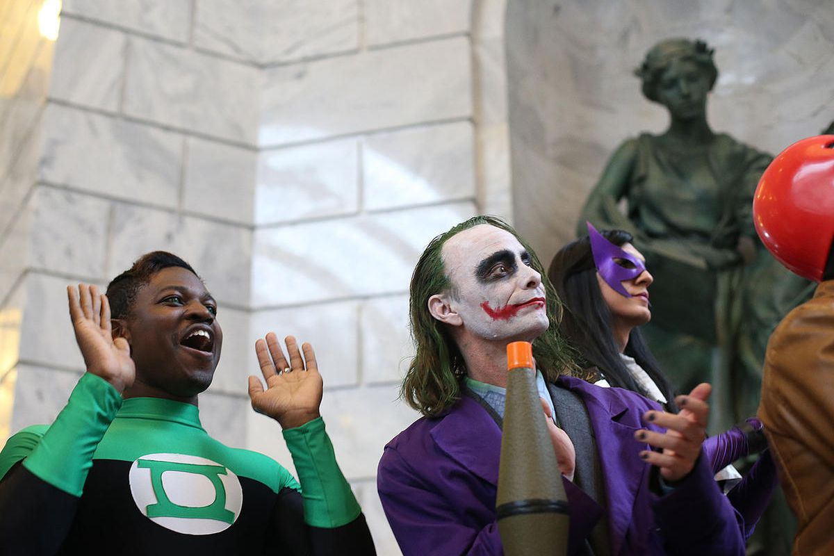 Victor Sine, as the Green Lantern, and Ryan Hahn, as The Joker, applaud as the guys lineup is announced at the Salt Lake Comic Con 2017 Press Conference at the Utah State Capitol on Wednesday, May 17, 2017.