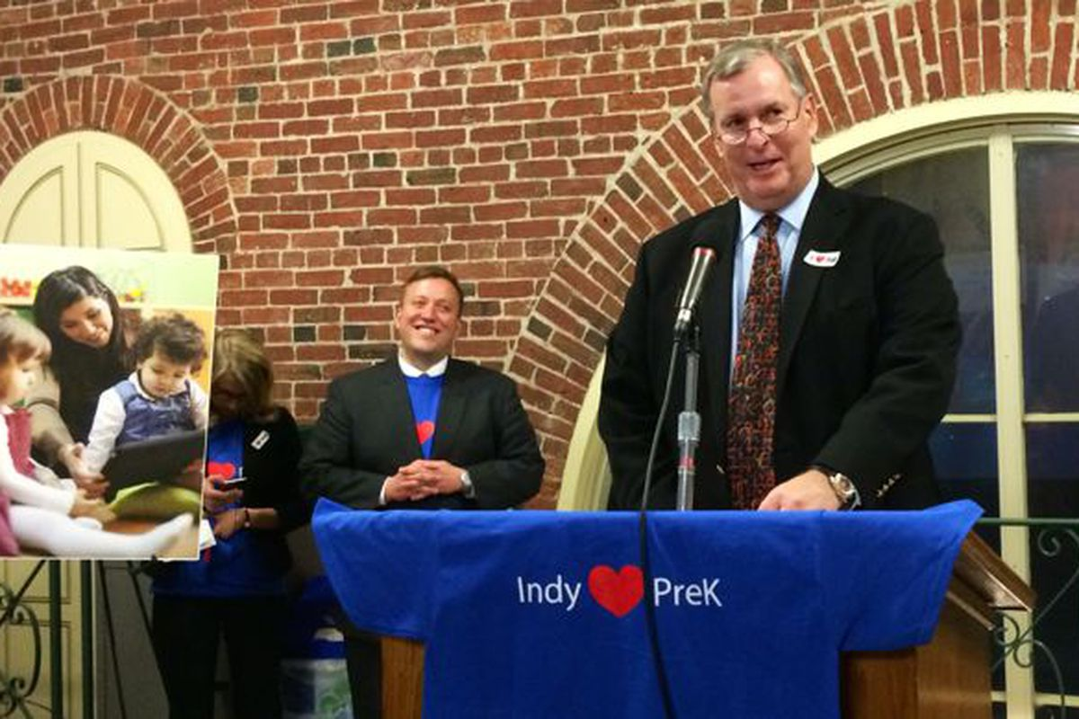 Indianapolis Deputy Mayor Jason Kloth looks on while Mayor Greg Ballard speaks at a December 2014 rally in support of his proposed preschool tuition program.