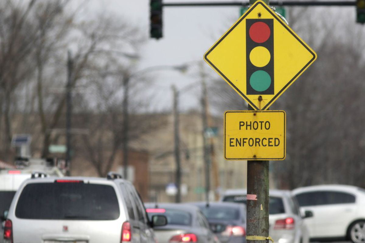 A sign warns motorists of the presence of a red light camera in Chicago in 2015.