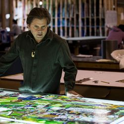 """Tom Holdman checks the progress of an art glass panel that will be part of """"The Roots of Knowledge,"""" a 200-foot-long stained glass installation for Utah Valley University, at Holdman Studios in Lehi on Friday, Nov. 4, 2016. A Guardian UK reporter called the work """"one of the most spectacular stained glass windows made in the past century."""""""