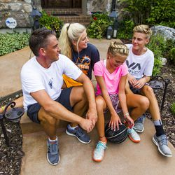 Kurt Christensen is pictured with his children McCall, 18, left, Elle, 13, and Adam, 15, at their home in Cottonwood Heights on Wednesday, Aug. 12, 2015.