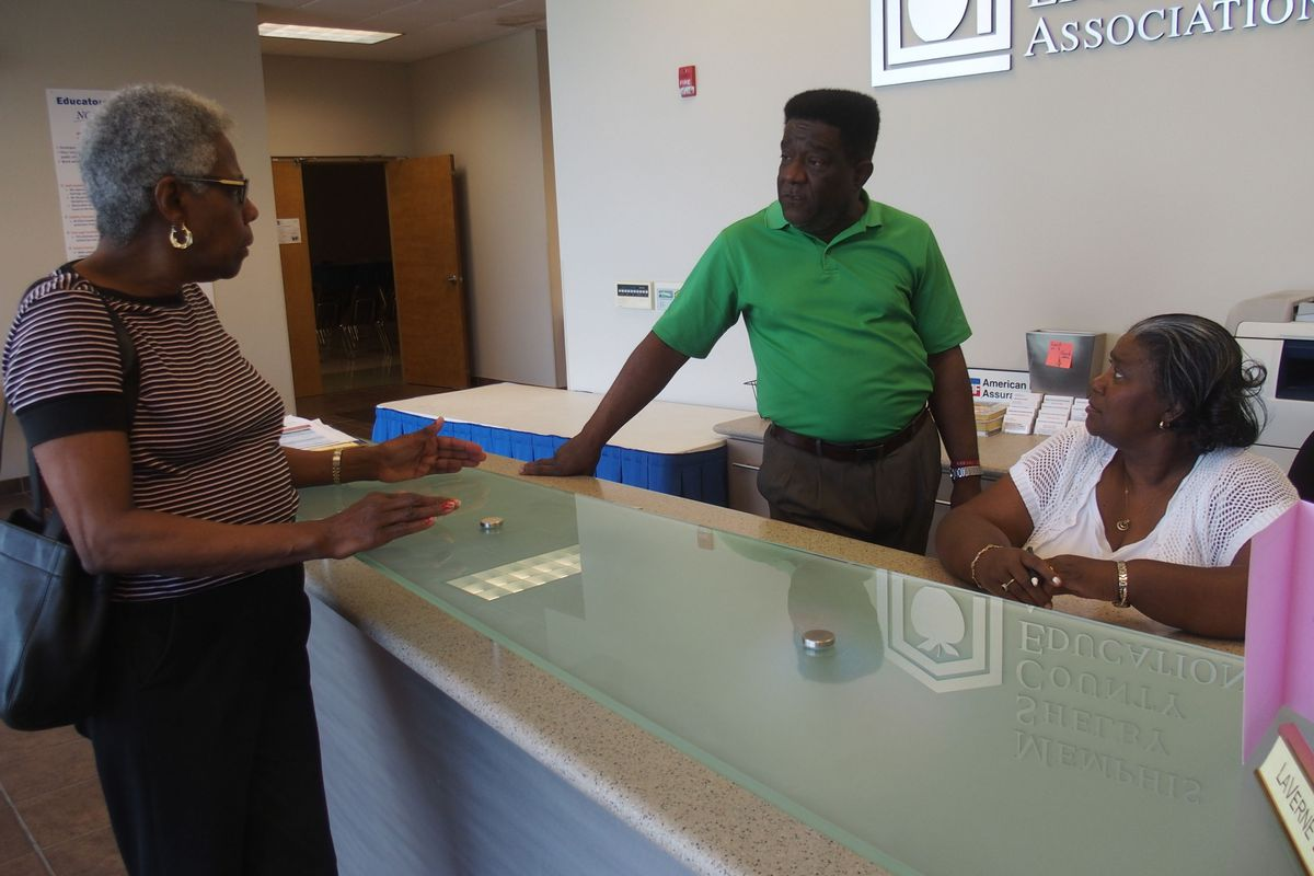 From left: Daisy Cleaves, president of Shelby County's Retired Teachers Association, discusses retirement benefits with teachers union president Keith Williams and retiree LaVerne Dickerson.