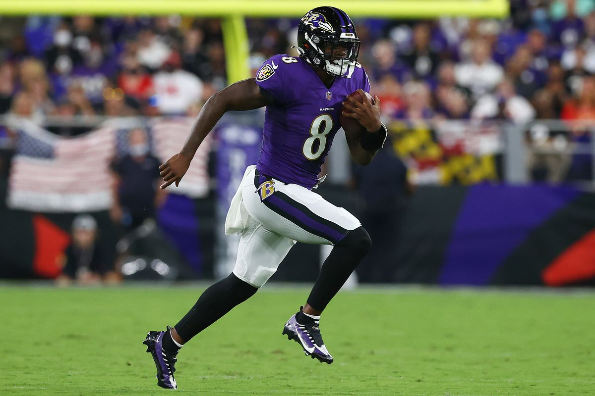 Lamar Jackson #8 of the Baltimore Ravens scrambles with the ball against the Kansas City Chiefs during the second quarter at M&T Bank Stadium on September 19, 2021 in Baltimore, Maryland.