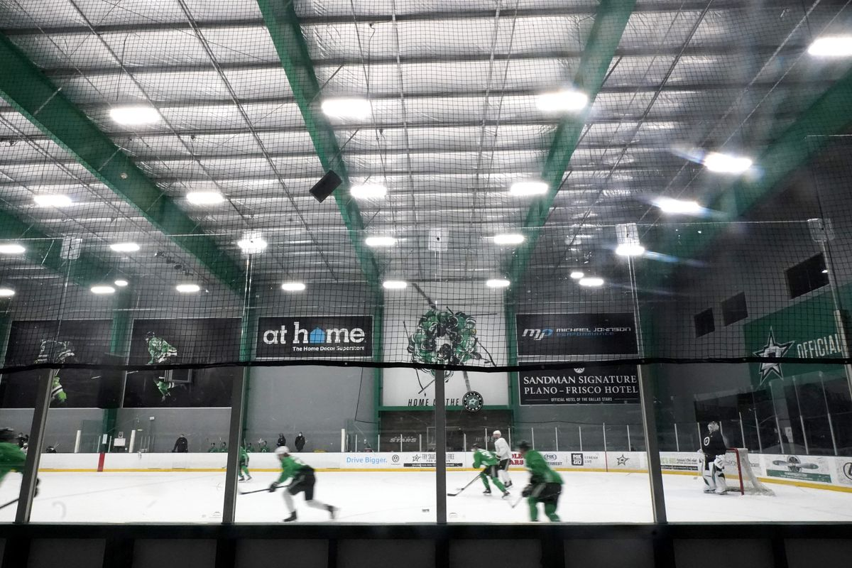 The Dallas Stars run drills during training camp. Eight positive coronavirus tests among players and staff have force the team to delay its season opener.