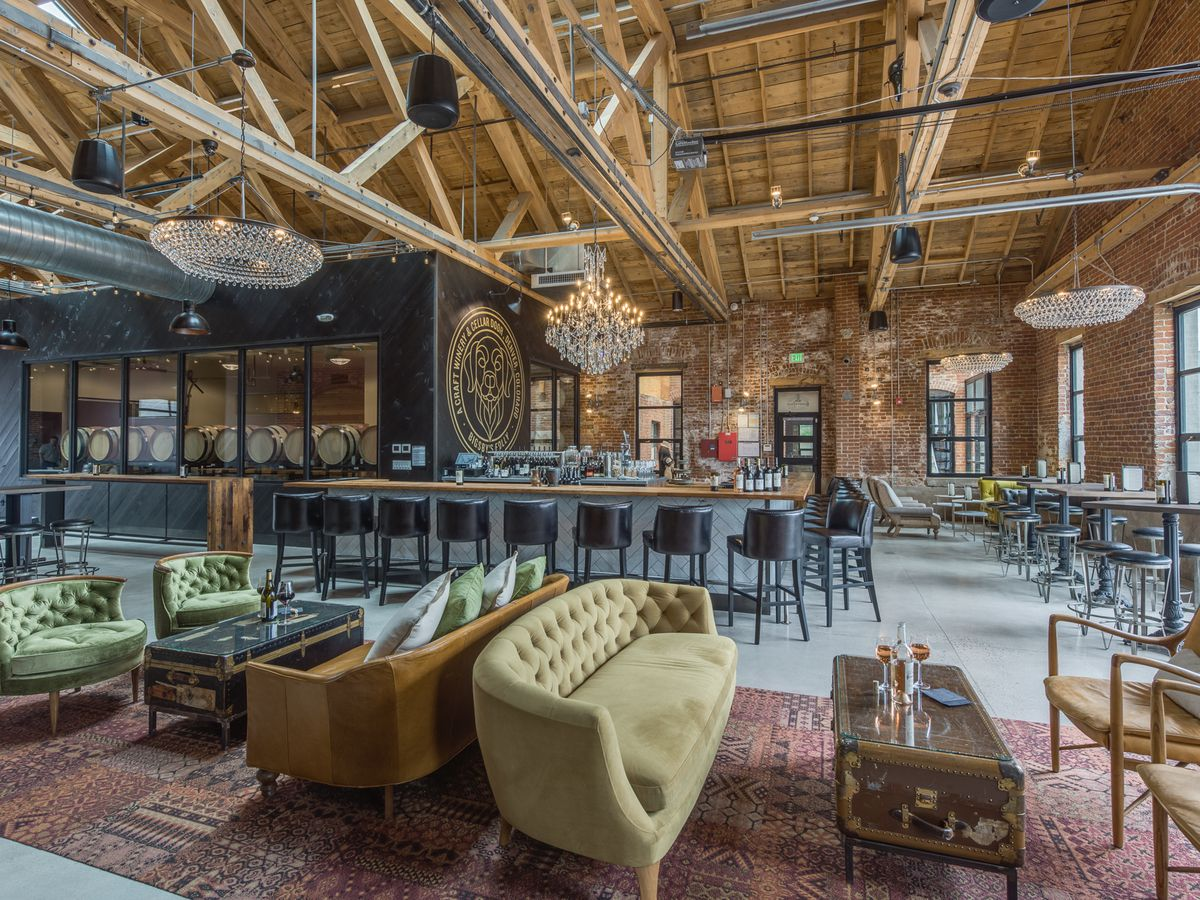 Wine bar with high ceilings and couches