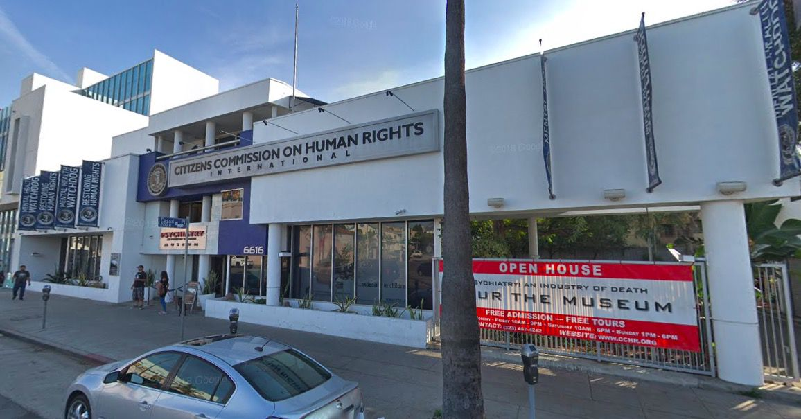 The exterior of the Psychiatry: An Industry of Death Museum in Los Angeles. The facade is white and there is a sign that reads: citizens commission on human rights.