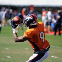 Broncos rookie WR John Diarse gets his hands on this pass.