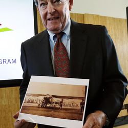 Airport Board Chairman Michael Gallivan holds a copy of a photo of Charles Lindbergh taken in Salt Lake City in 1927 as new Salt Lake City International Airport terminal design details are unveiled in Salt Lake City, Tuesday, Sept. 29, 2015.