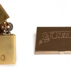 """In God We Trust Customizable Brass Lighter ($30) and """"In it to Win it"""" Engraved Card Case ($60)."""