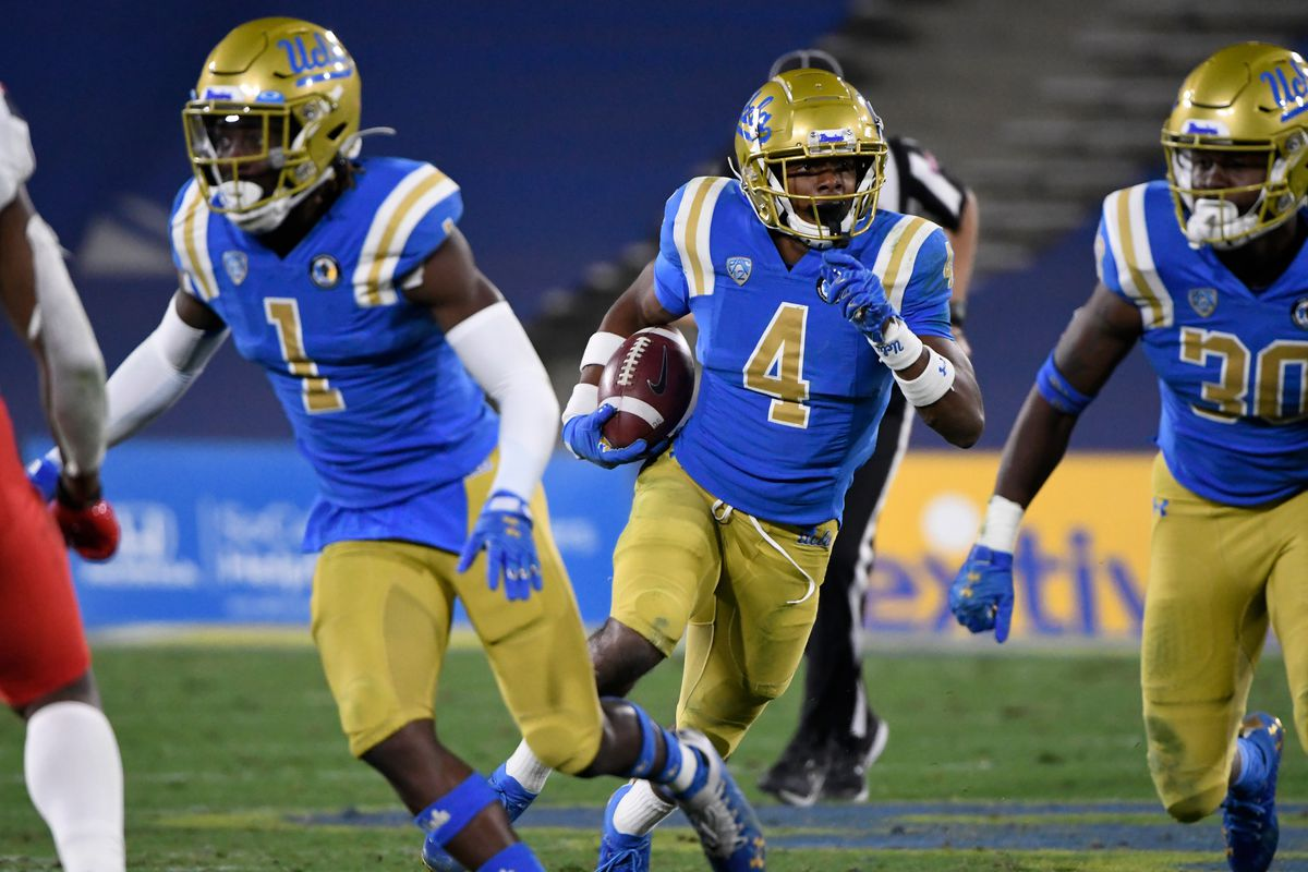 UCLA Bruins defensive back Stephan Blaylock runs back an interception in the fourth quarter against the Arizona Wildcats at the Rose Bowl.