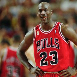 In this June 9, 1996 file photo Chicago Bulls Michael Jordan stands during a break at the end of an NBA Basketball game against the Seattle SuperSonics in Seattle. (AP Photo/Beth A. Keiser, File)