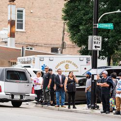 Family and friends of the Little Village fire victims, as well as media, stand outside Our Lady Of Tepeyac church as the hearses carrying the victims drive away on September 1, 2018. | Max Herman/For the Sun-Times