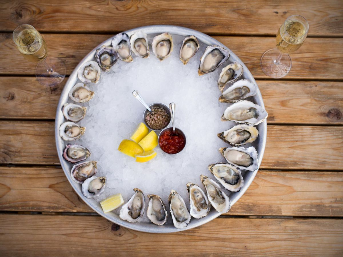 A top-down view of an oyster platter filled with crushed ice at White Swan Public House.