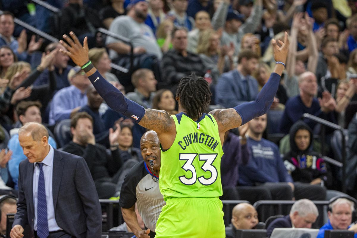 Minnesota Timberwolves forward Robert Covington raises his arms to pump up the crowd after making a three point shot in the second half against the Cleveland Cavaliers at Target Center.
