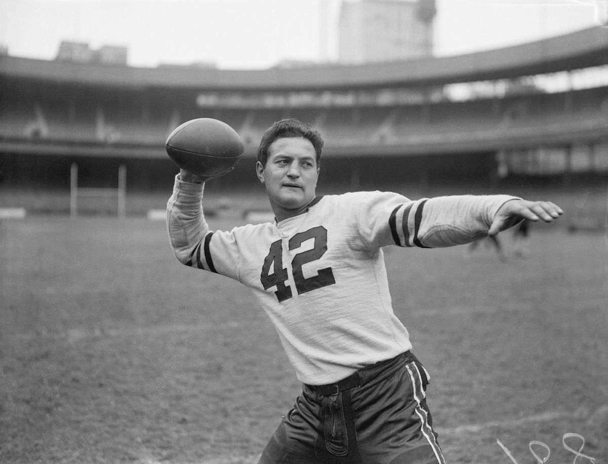 Sid Luckman in Passing Position with Football