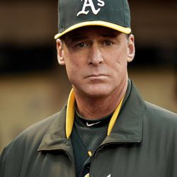Oakland Athletics manager Bob Melvin waits for the baseball game to begin against the Boston Red Sox Friday, Aug. 31, 2012, in Oakland, Calif.